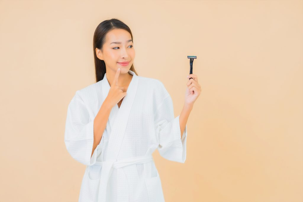 Portrait beautiful young asian woman with shaving on isolated background
